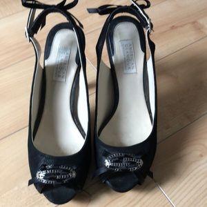 High heeled black pumps